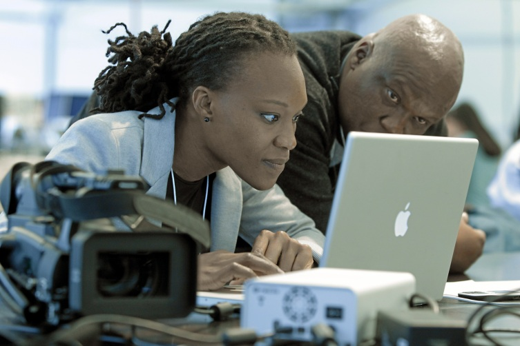 DAVOS/SWITZERLAND, 27JAN10 - Journalists work on their computers at the media centre during the Annual Meeting 2010 of the World Economic Forum in Davos, Switzerland, January 27, 2010. Copyright by World Economic Forum swiss-image.ch/Photo by Andy Mettler